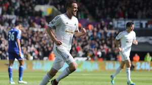 Swansea City's Gylfi Sigurdsson celebrates scoring against Chelsea