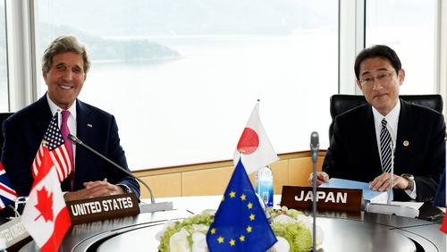John Kerry and Japanese Foreign Minister Fumio Kishida pose during the first session of the G7 Foreign Ministers' meeting