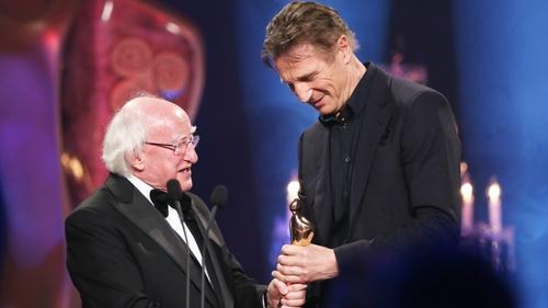President Michael D Higgins presents award to Liam Neeson