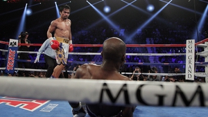 Manny Pacquiao watches Timothy Bradley sprawl to the mat at the MGM Grand Arena