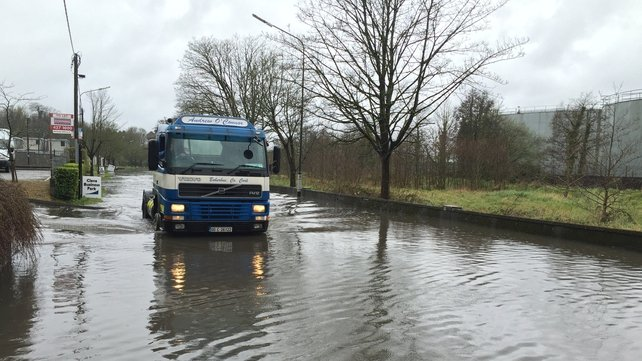 A truck makes it way through flood water on the Monaghan Road in Cork