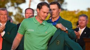 Jordan Spieth presents champion Danny Willett with the Green Jacket