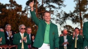Danny Willett beams in the green jacket