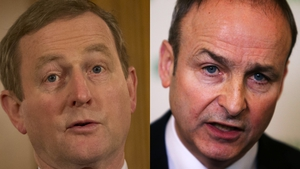 Fianna Fáil leader Micheál Martin (R) sees his party lead Taoiseach Enda Kenny's Fine Gael by four points