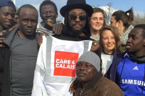 will.i.am visits Calais for the second time this week and distributed aid