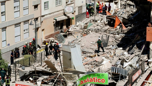 Rescue workers at the scene of the building collapse