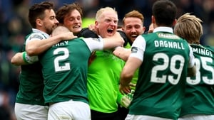 Hibs 'keeper Conrad Logan is mobbed at the end