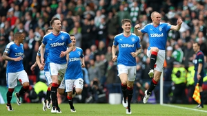 Kenny Miller (R) celebrates his goal