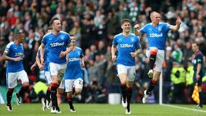 Kenny Miller (R) celebrates his goal