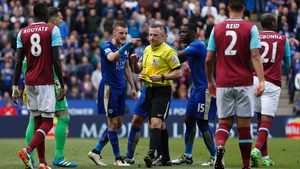 Jamie Vardy has a word with the ref after being sent off