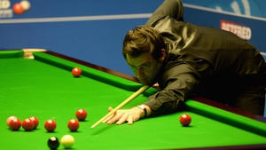 Ronnie O'Sullivan plays a shot against David Gilbert during their first round match of the 2016 Betfred World Snooker Championship
