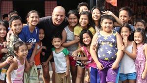 Mark Crosbie with local schoolchildren in Manila