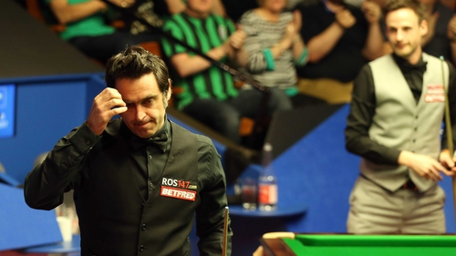 Ronnie O'Sullivan leaves the Crucible auditorium after defeating David Gilbert 10-7 in the opening round at the World Championship