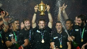 Richie McCaw holds aloft the 2015 World Cup