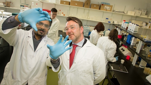 Professor Suresh Pillai (r) from Sligo IT and John Browne of Kastus Technologies view the anti-superbug solution on glass