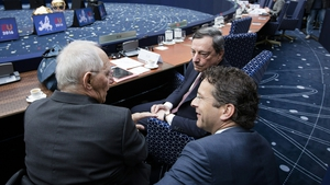 Jereon Dijsselbloem, head of the eurozone ministers, speaks to German minister Wolfgang Schaeuble and Mario Draghi of the ECB