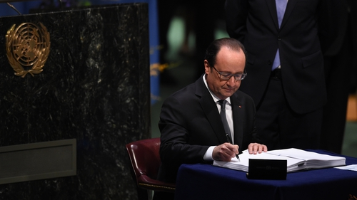 Francois Hollande was the first of scores of leaders to sign the deal
