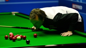 Sam Baird lines up a shot during his second-round match against Mark Selby
