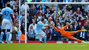 Sergio Aguero scores from the penalty spot