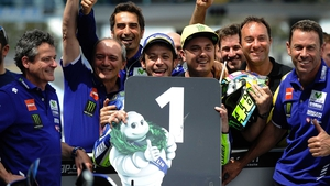 Valentino Rossi celebrates his first pole position in almost a year