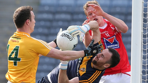 Antrim's Chris Kerr under pressure from Jim McEneaney of Louth