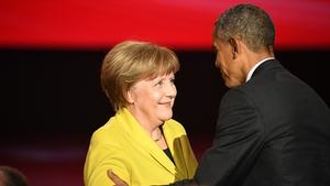 Angela Merkel and Barack Obama are seen on stage at the opening evening of the Hannover Messe trade fair