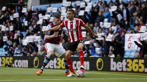 Dusan Tadic shields the ball from Aston Villa's Kevin Toner