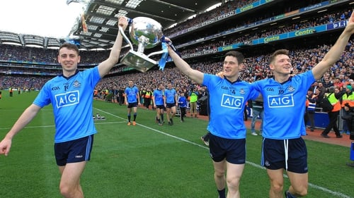 Cormac Costello, Diarmuid Connolly and Paul Flynn celebrate after winning a fourth League title on the bounce
