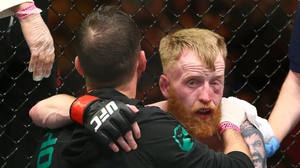 A dejected Paddy Holohan with coach john Kavanagh after losinig to Louis Smolka in October 2015