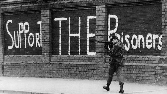 13th May 1981: A British soldier looking out for snipers as he patrols the Falls Road in Belfast. (Getty)