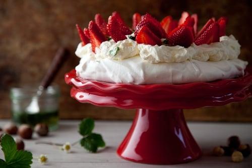 Hazelnut Pavlova with Summer Strawberries, Mascarpone Cream and Basil Drizzle
