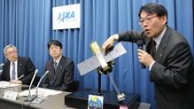 Takashi Kubota, JAXA space program director, announces the decision