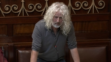 Mick Wallace said he was willing to take a refugee in himself