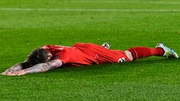 Alberto Moreno of Liverpool reacts during the semi-final first-leg defeat