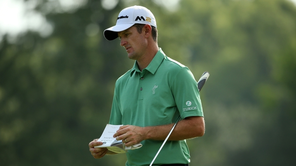 Justin Rose's fate rests in the balance after the second round was suspended due to bad light