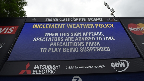 Inclement weather signs are posted along the course during the third round of the Zurich Classic