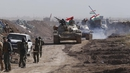 Iraqi pro-government forces retake the town of al-Bashir
