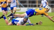 Patrick Curran with Pat O'Connor tussle for the ball in the Allianz Division 1 final