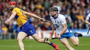 Clare's Peter Duggan evades the challenge of Waterford's Kevin Moran
