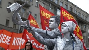 Russian Communist party supporters hold the iconic communist symbols of a hammer and sickle at a rally in Moscow