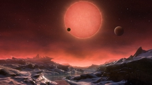 An artist's impression of an imagined view from the surface one of the three planets (Pic: ESO/M Kornmesser)