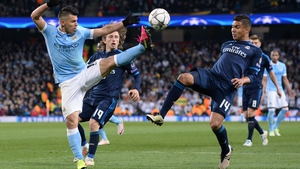 Sergio Aguero (L) battles with Luka Modric (C) and Casemiro (R) during the first leg