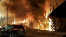 Firefighters have been unable to halt the wildfire