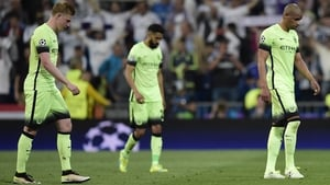 Dejected Man City players traipse from the Bernabeu pitch