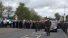 Around a dozen men, dressed in paramilitary-style uniform, accompanied the cortege