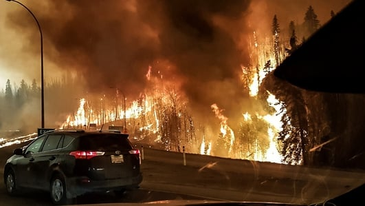 100,000 citizens flee fires in Canadian city