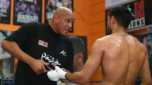 Virgil Hunter cuts the tape off Amir Khan's hands after a training session