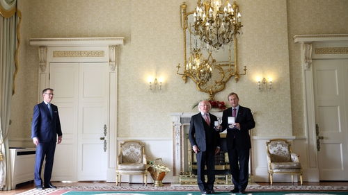 Enda Kenny receives his seal of office from PresidentMichael D Higgins