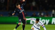 Marco Verratti (l) in action for Paris Saint Germain
