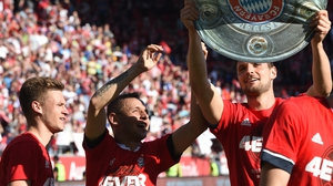 Bayern Munich's Brazilian defender Rafinha (C) toasts their league success